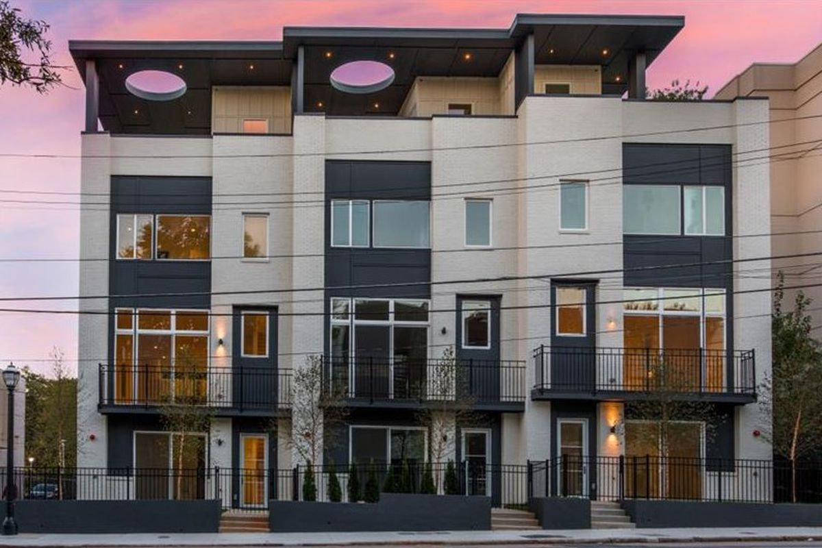 A photo of three new townhomes in Atlanta for sale.