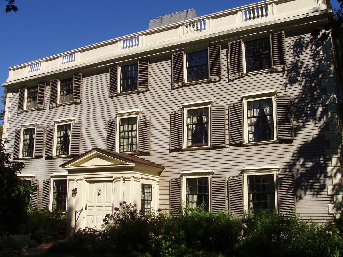 The exterior of a three-story federal-style house.