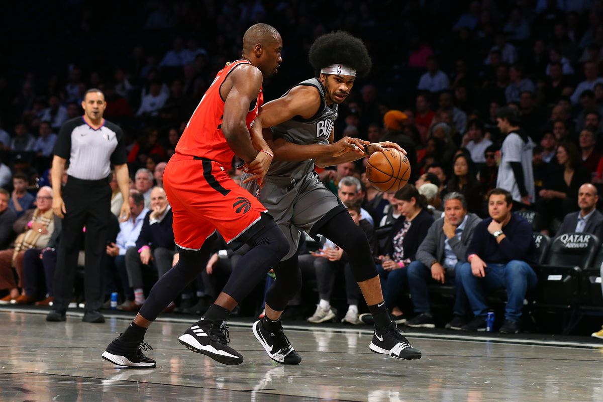 Jarrett Allen of the Brooklyn Nets in action against Serge Ibaka of the Toronto Raptors at Barclays Center on February 12, 2020 in New York City.Brooklyn Nets defeated the Toronto Raptors 101-91.