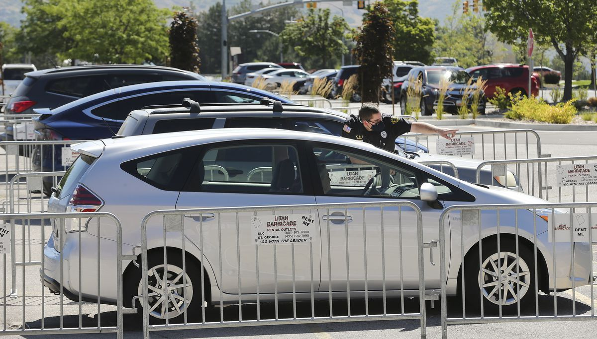 Motorists are directed as they line up for COVID-19 testing near University of Utah Health's Sugar House Health Center in Salt Lake City on Saturday, July 11, 2020.