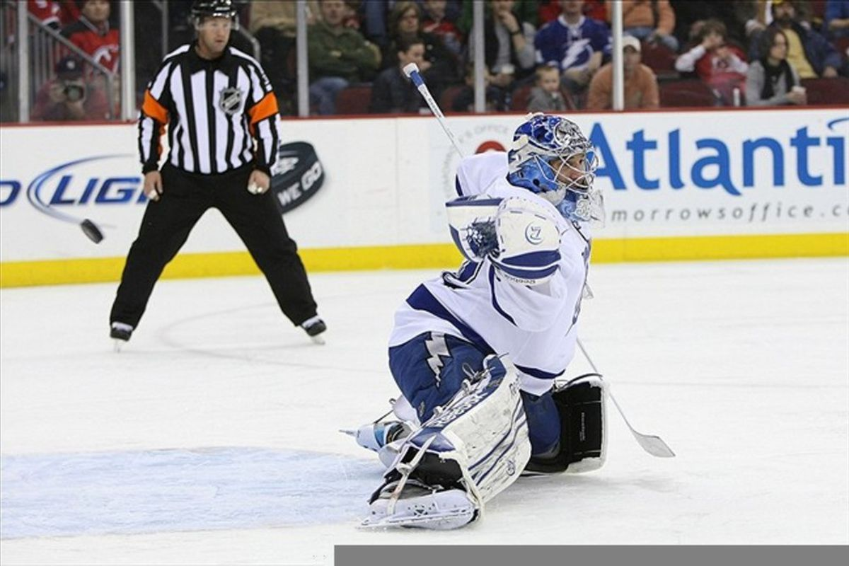 Feb 26 2012; Newark, NJ, USA; Tampa Bay Lightning goalie Mathieu Garon (32) makes a save against the New Jersey Devils during the second period at the Prudential Center.  Mandatory Credit: Alan Maglaque-US PRESSWIRE