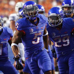 Boise State players celebrate making an interception against BYU during NCAA football in Boise, Thursday, Sept. 20, 2012.