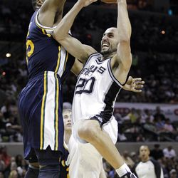 San Antonio Spurs' Manu Ginobili (20), of Argentina, is defended by Utah Jazz's Derrick Favors, left, during the third quarter of Game 1 of a first-round NBA basketball playoff series on Sunday, April 29, 2012, in San Antonio.  San Antonio won 106-91.(AP Photo/Eric Gay)