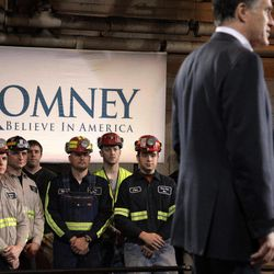 Consol Energy Research and Development Facility employees listen to Republican presidential candidate, former Massachusetts Gov. Mitt Romney at a campaign rally in South Park Township, Pa., Monday, April 23, 2012.