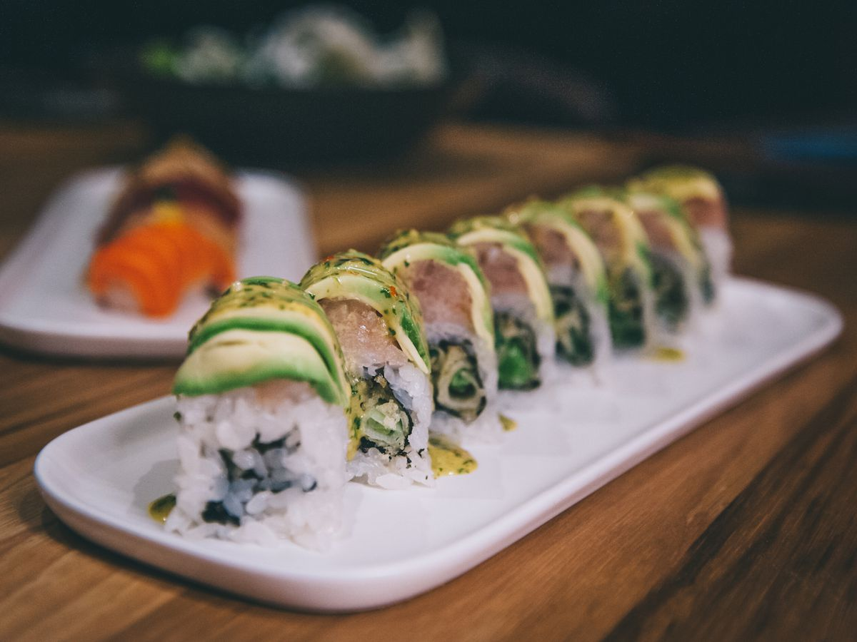 Avocado-topped sushi roll