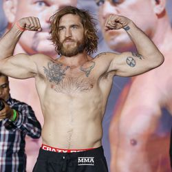 Tom Lawlor flexes at the Liddell vs. Ortiz 3 ceremonial weigh-ins in Inglewood, Calif.