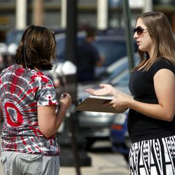 In this Sept. 9, 2011, photo, Mellissa Brown, right, a volunteer for Organizing for America, collects signatures for a petition in Columbus, Ohio, in a ballot repeal effort by opponents of the Ohio's new elections law. After years of expanding when and how people can vote, state legislatures now under new Republican control are moving to trim early voting days, beef up identification requirements and put new restrictions on how voters are notified about absentee ballots.