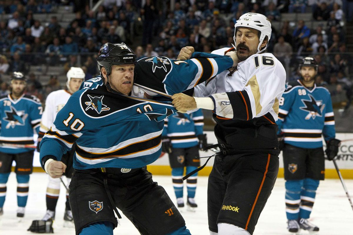 Mar 19, 2012; San Jose, CA, USA; San Jose Sharks left wing Brad Winchester (10) fights Anaheim Ducks right wing George Parros (16) during the second period at HP Pavilion. Mandatory Credit: Jason O. Watson-US PRESSWIRE