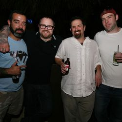 Coppa's Jamie Bissonnette is flanked by bearded men.