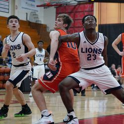 Lincoln Park's Tavis Stampley (23) pushes Naperville North's Riley Thompson (10) out of the lane, Saturday 02-02-19. Worsom Robinson/For the Sun-Times.