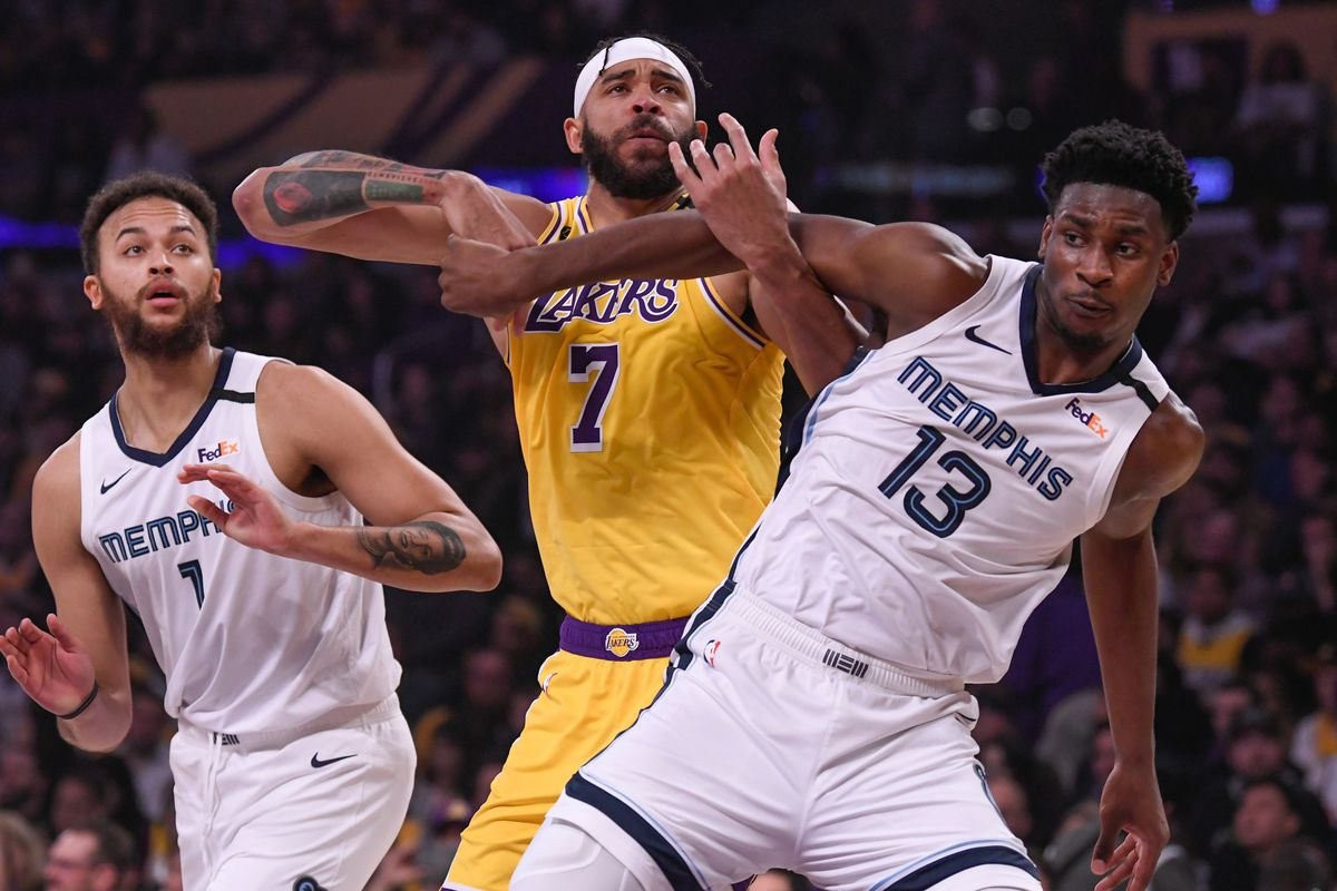Los Angeles Lakers center JaVale McGee and Memphis Grizzlies forward Jaren Jackson Jr. tangle as battle for rebounding position during the first quarter at Staples Center. Lookin on at left is Memphis Grizzlies forward Kyle Anderson.