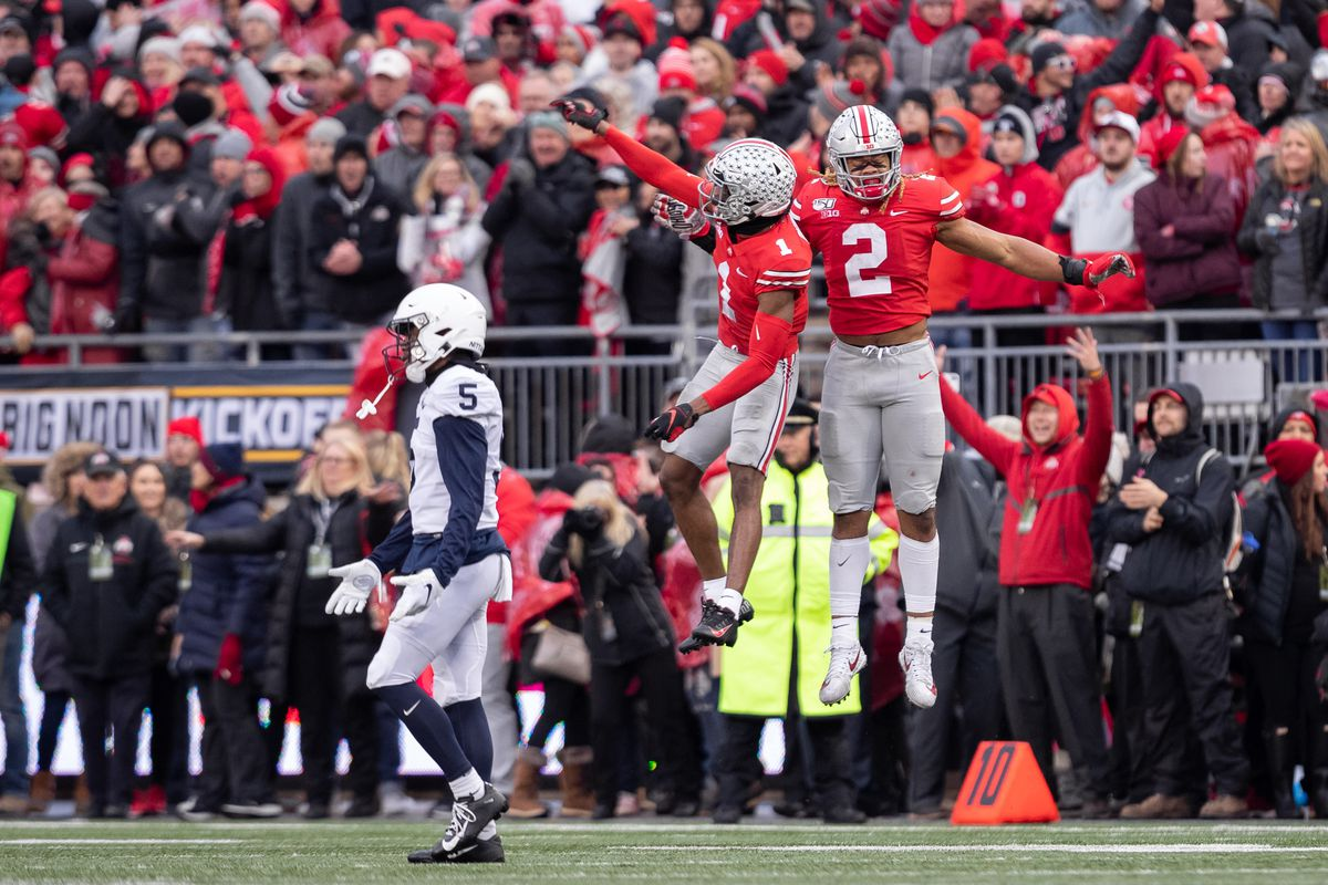 Chase Young of the Ohio State Buckeyes and Jeff Okudah of the Ohio State Buckeyes celebrate after the Penn State Nittany Lions received a false start penalty during game action between the Ohio State Buckeyes and the Penn State Nittany Lions on November 23, 2019, at Ohio Stadium in Columbus, OH.
