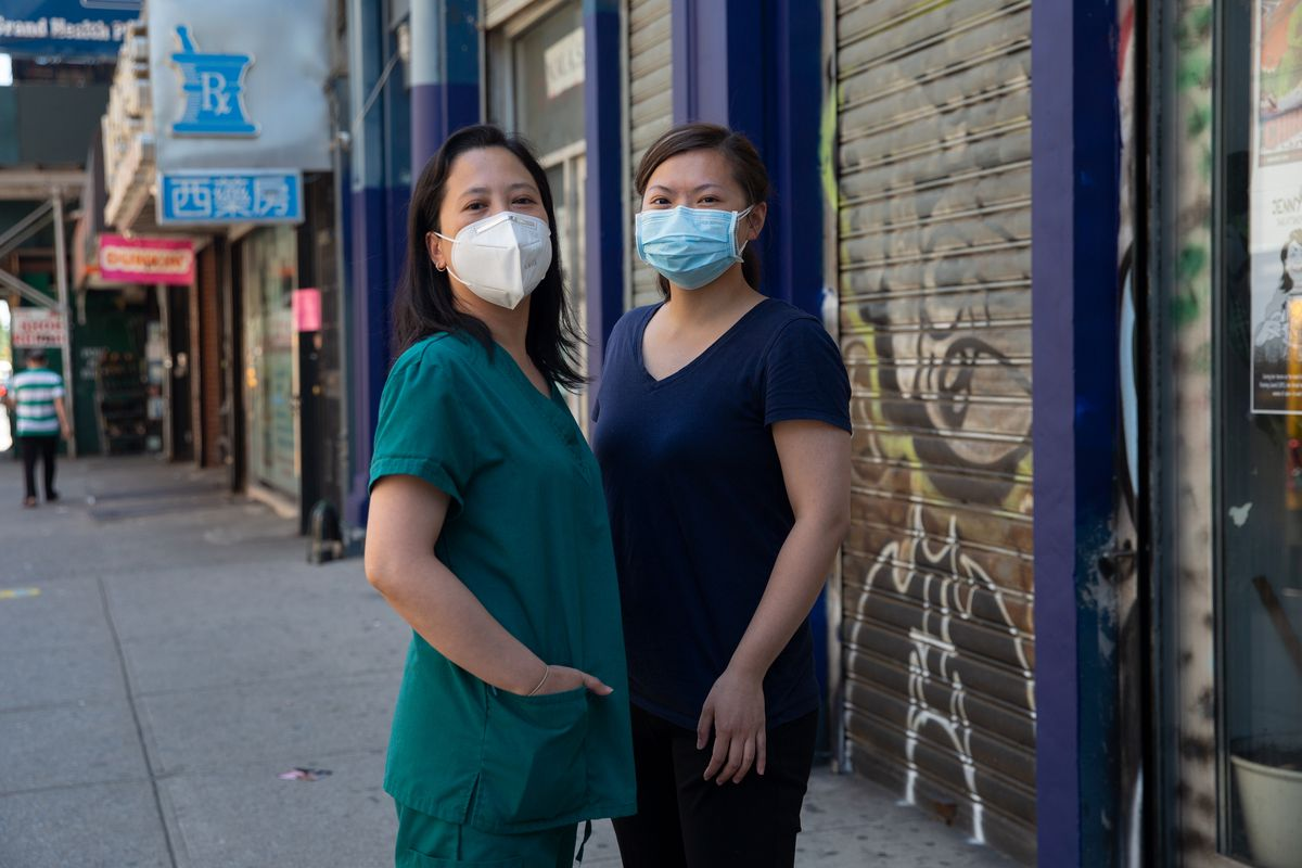 Medical workers Yan Ling Xu, left, and Huimin who asked that her last name be withheld, say they were discriminated against by the lab that employed them, June 17, 2021.