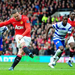 Manchester United's Wayne Rooney scores his side's first goal of the game from the penalty spot against Queen Park Rangers  during the English Premier League match at Old Trafford, Manchester England Sunday April 8, 2012.
