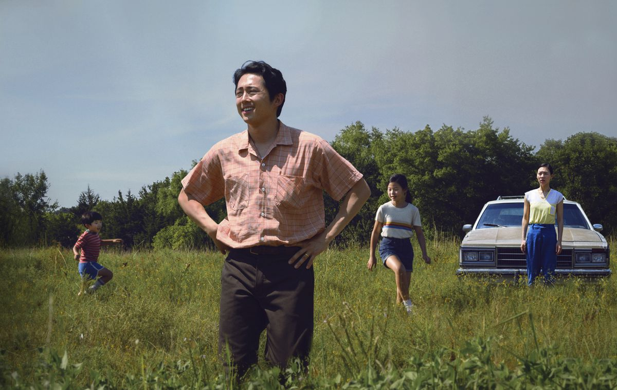 """Steven Yeun (foreground) is shown in a scene from """"Minari."""" The film was nominated for best feature by the Independent Film Spirit Awards. Yeun was also nominated for best actor and Lee Isaac Chung received a nomination for best director."""