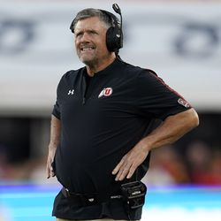 Utah coach Kyle Whittingham watches from the sideline during the first half of the team's NCAA college football game against Southern California on Saturday, Oct. 9, 2021, in Los Angeles.