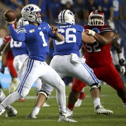 BYU quarterback Zack Wilson shoots a pass during Utah-BYU football game at LaVell Edwards Stadium in Provo on Thursday, August 29, 2019.