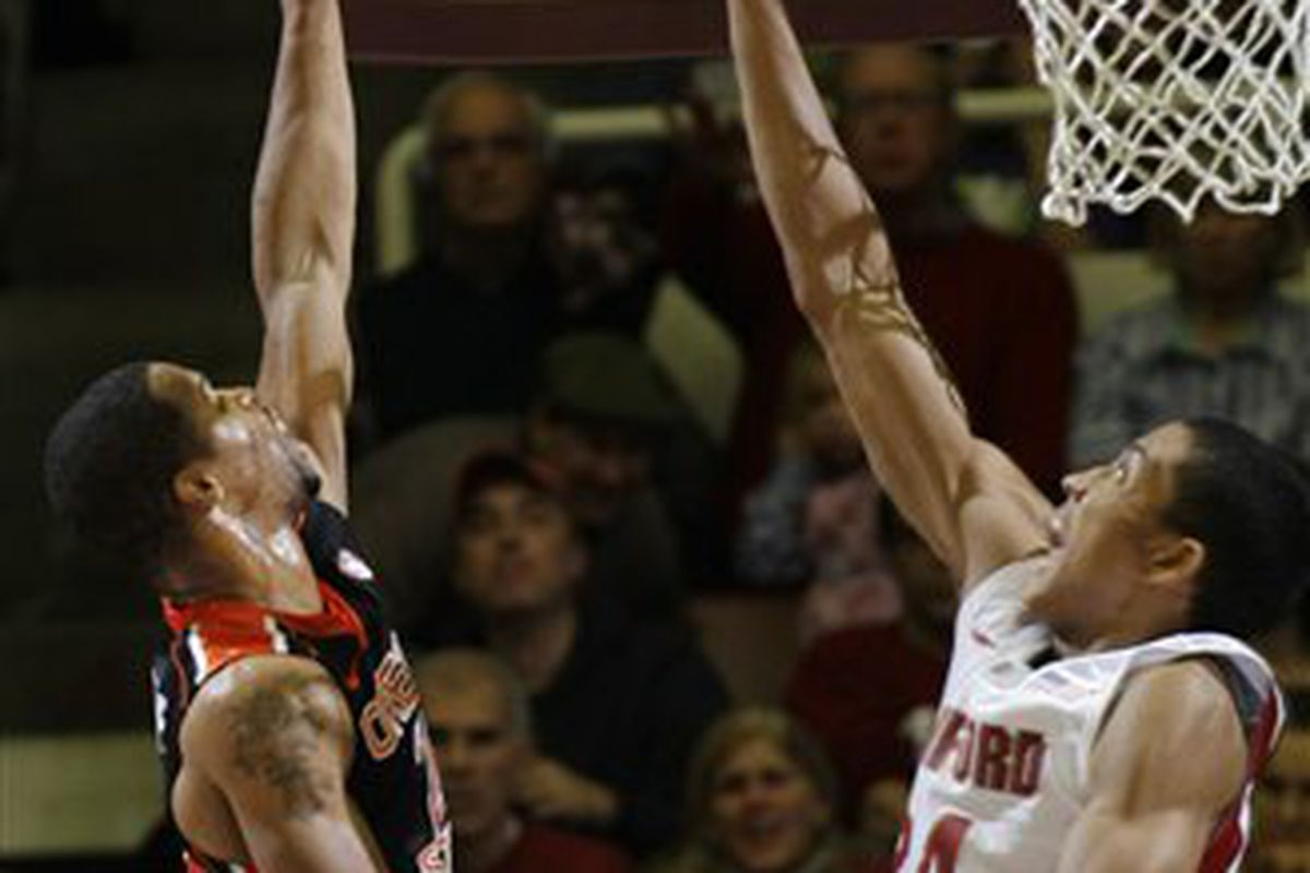 Calvin Haynes shoots over Stanford's Josh Huestis. Haynes finished with only 9 points in the Beavers' 70-56 loss.  <em>(AP Photo/Paul Sakuma) </em>