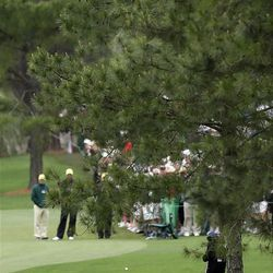 Lee Westwood, of England, takes his second shot on the seventh hole during the second round the Masters golf tournament Friday, April 6, 2012, in Augusta, Ga. (AP Photo/David J. Phillip)