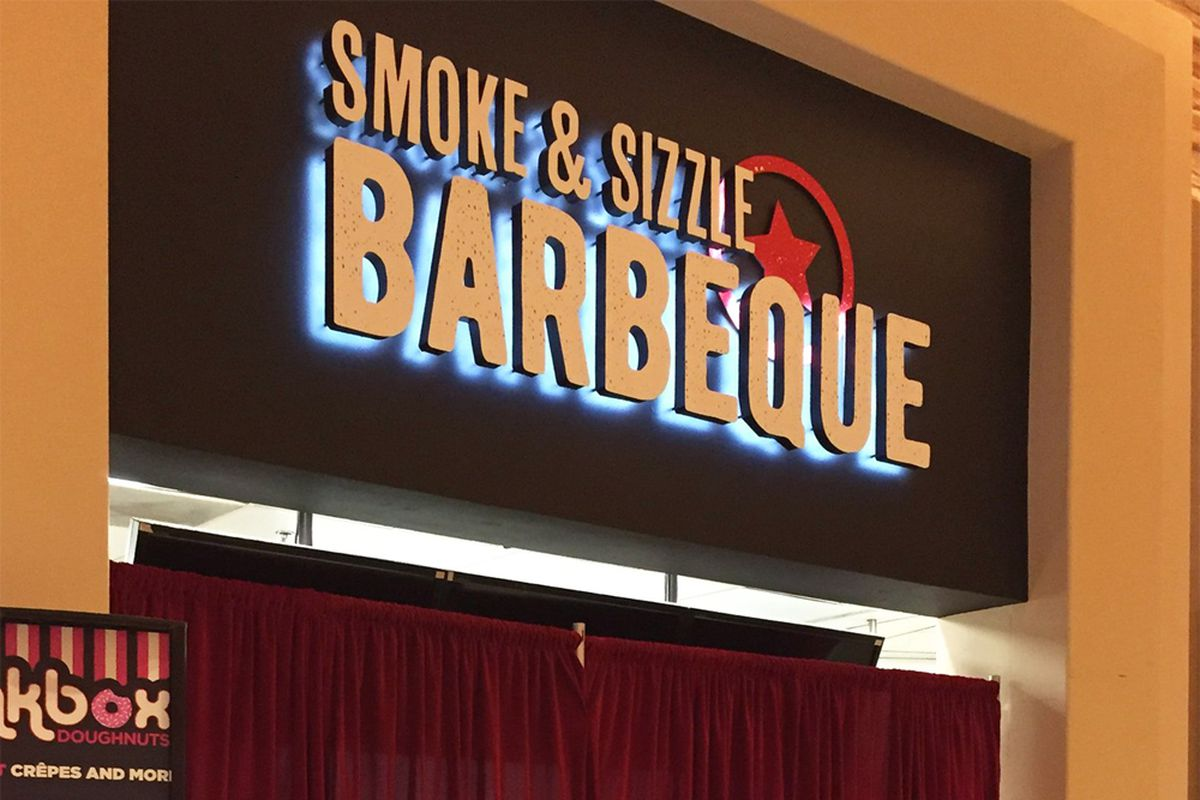 The exterior of the under construction Smoke & Sizzle Barbecue at the Caesars Palace Forum Food Court.