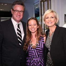 Milly designer Michelle Smith with Joe Scarborough and Mika Brzezinski at the opening of the Milly Madison Avenue boutique  (Photo by Thomas Concordia/Getty Images)