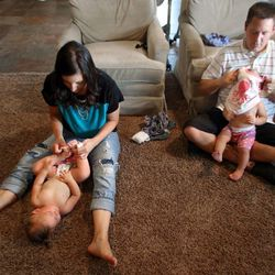 Camilla and Trent Hyde get the twins ready for bed in Syracuse on Thursday, Aug. 1, 2013.