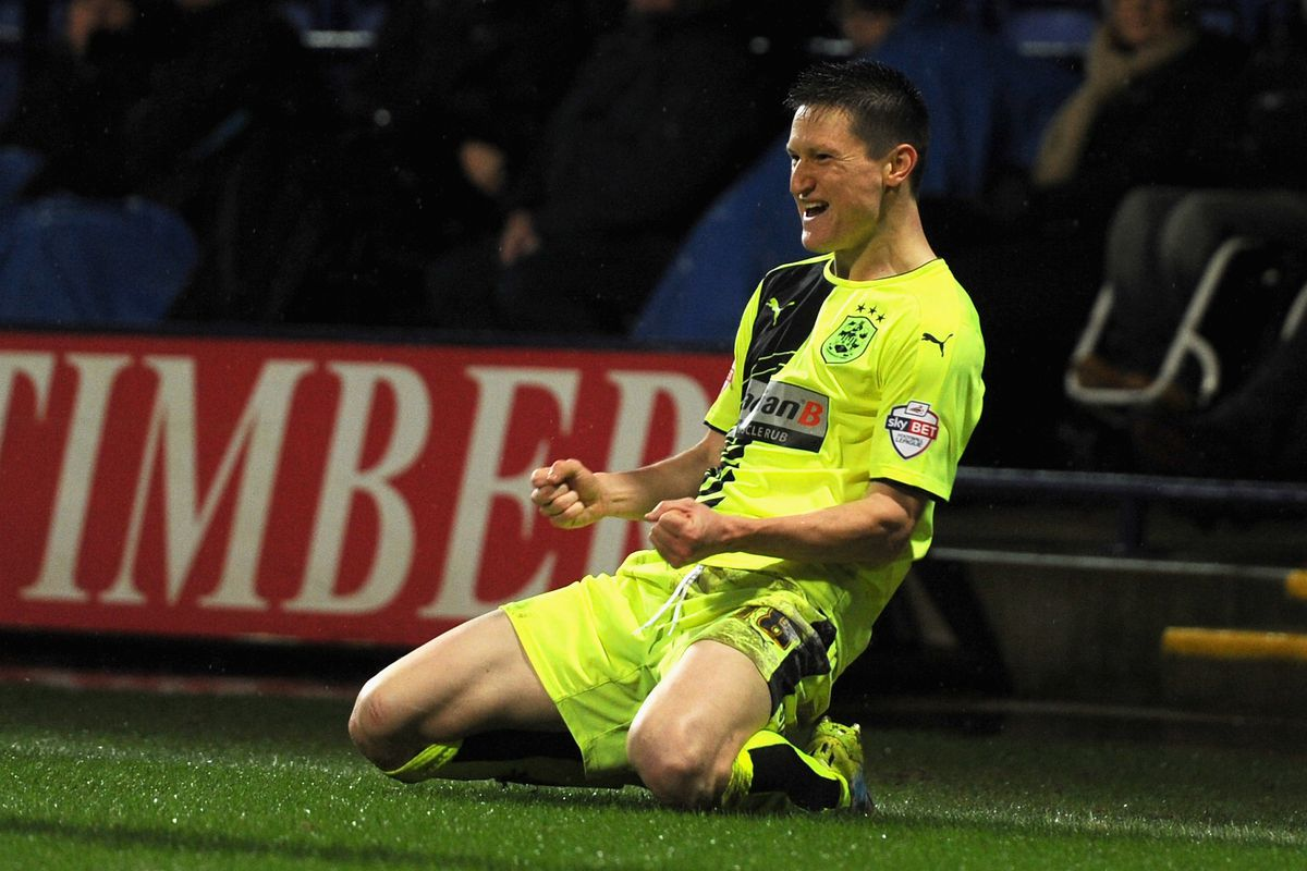Bolton suck: Lolley opened the scoring for Huddersfield at the Macron