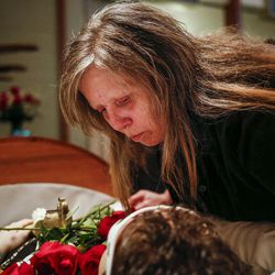 Diana Hall kisses her son, Matt Hall, goodbye during his funeral at Myers Mortuary in Ogden on Saturday, April 15, 2017. Matt Hall was in jail for 15 months until he smashed his head into a wall and jumped off a railing in February. He was paralyzed from the shoulders down until dying from his injuries on April 7.