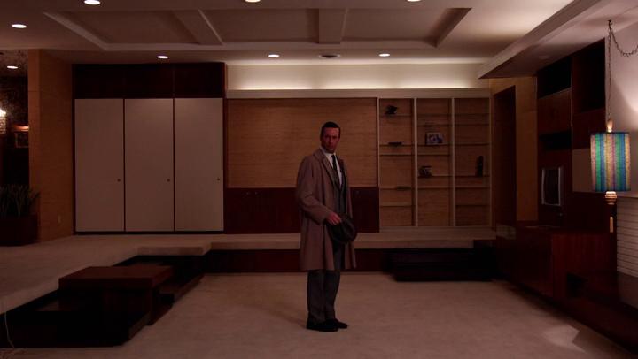 Mad Men's Don Draper stands in the empty, sunken living room of his empty, midcentury modern apartment in Manhattan.