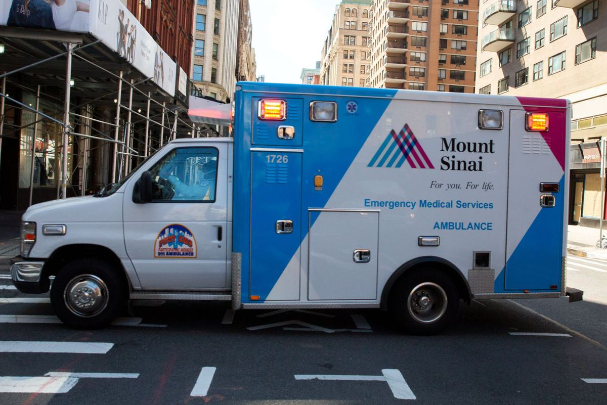 A Mount Sinai ambulance races through lower Manhattan during the height of the coronavirus outbreak.