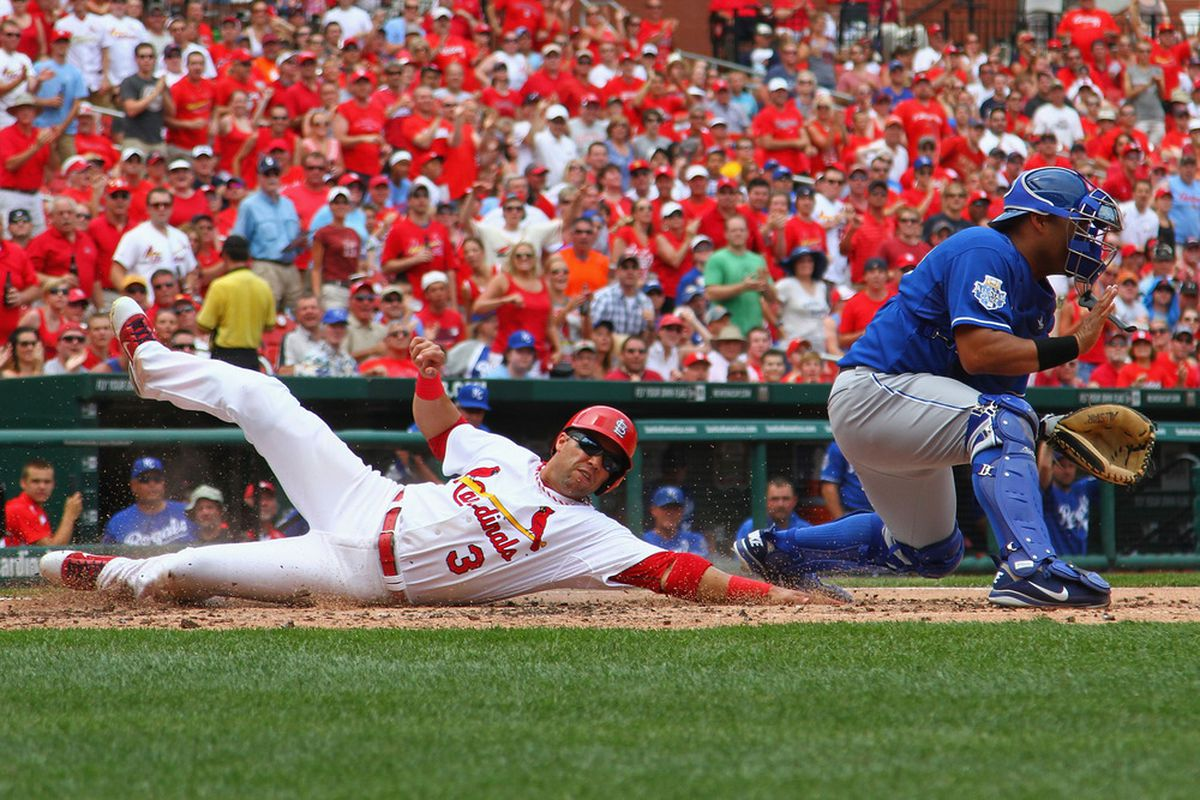 ST. LOUIS, MO - JUNE 16: Carlos Beltran #3 of the St. Louis Cardinals scores a run against Brayan Pena #27 of the Kansas City Royals at Busch Stadium on June 16, 2012 in St. Louis, Missouri.  (Photo by Dilip Vishwanat/Getty Images)
