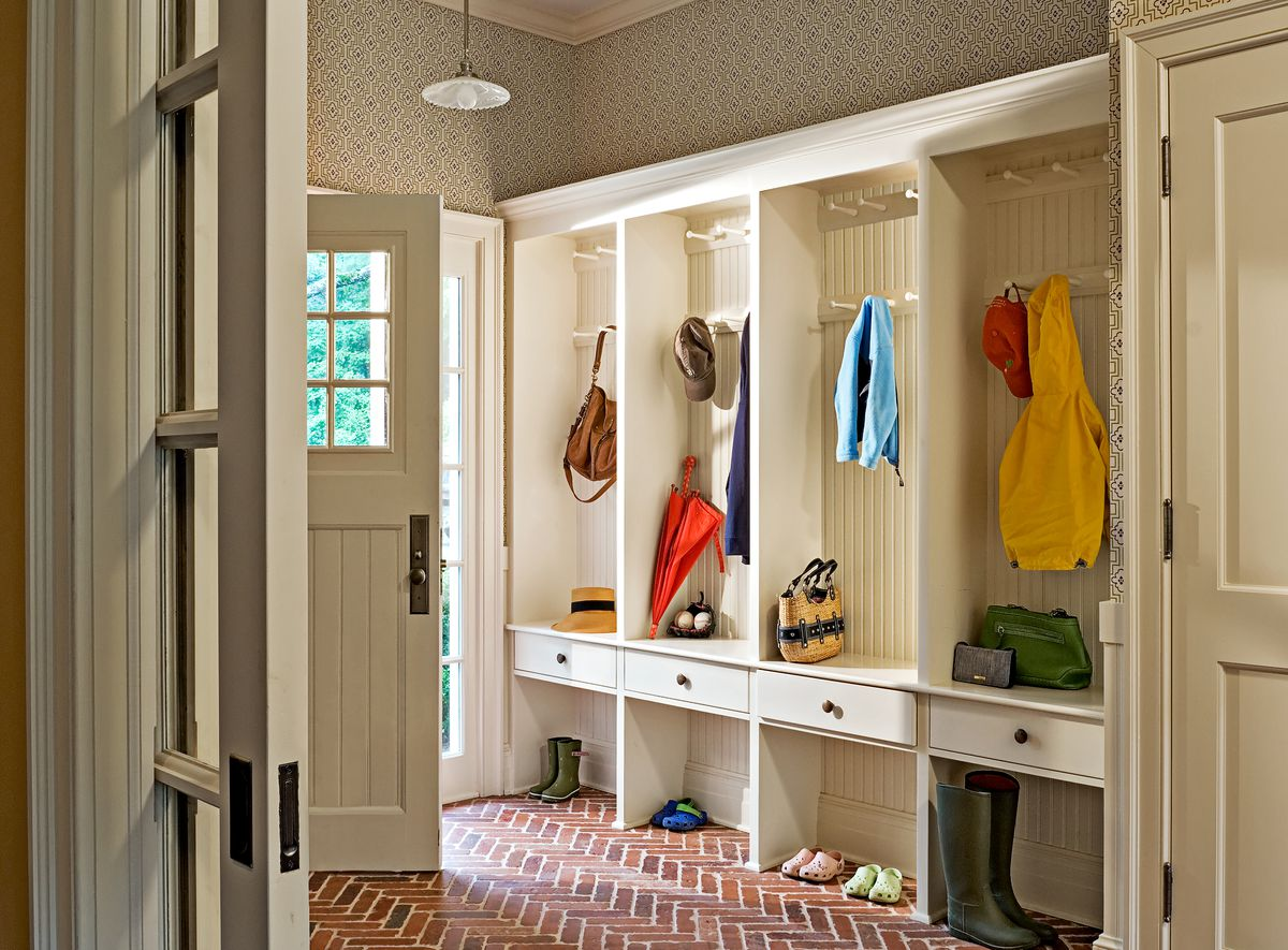 Mudroom with hooks for coats and bags.