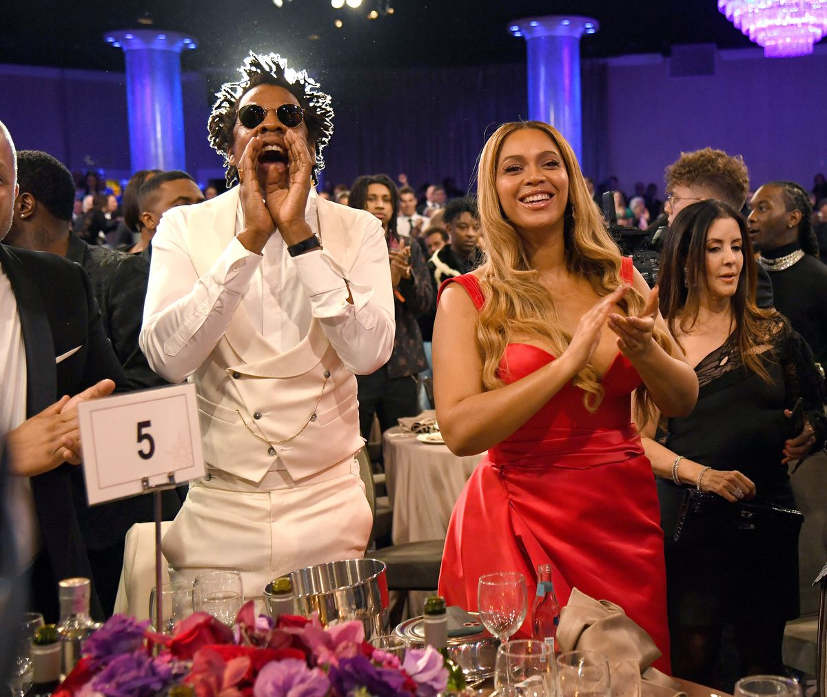 Celebrity Charity: Beyonce and Jay-Z standing at a charity gala.
