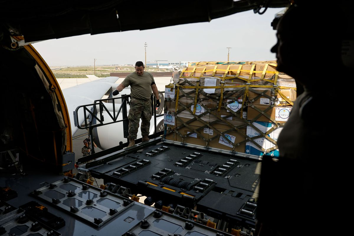 Members of the Utah Air National Guard's 151st Air Refueling Wing load equipment and supplies to assist Nepal's COVID-19 response on a KC-135 at Roland R. Wright Air National Guard Base in Salt Lake City on Thursday, Aug. 26, 2021.