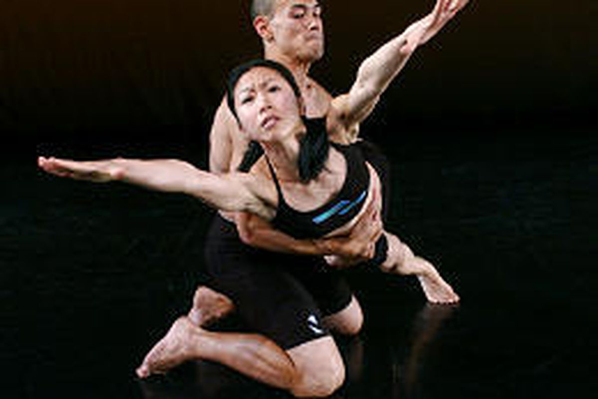"""RDT dancers Chien-Ying Wang, front, and Thayer Jonutz rehearse """"Duets to Brazilian-Indian Music."""""""