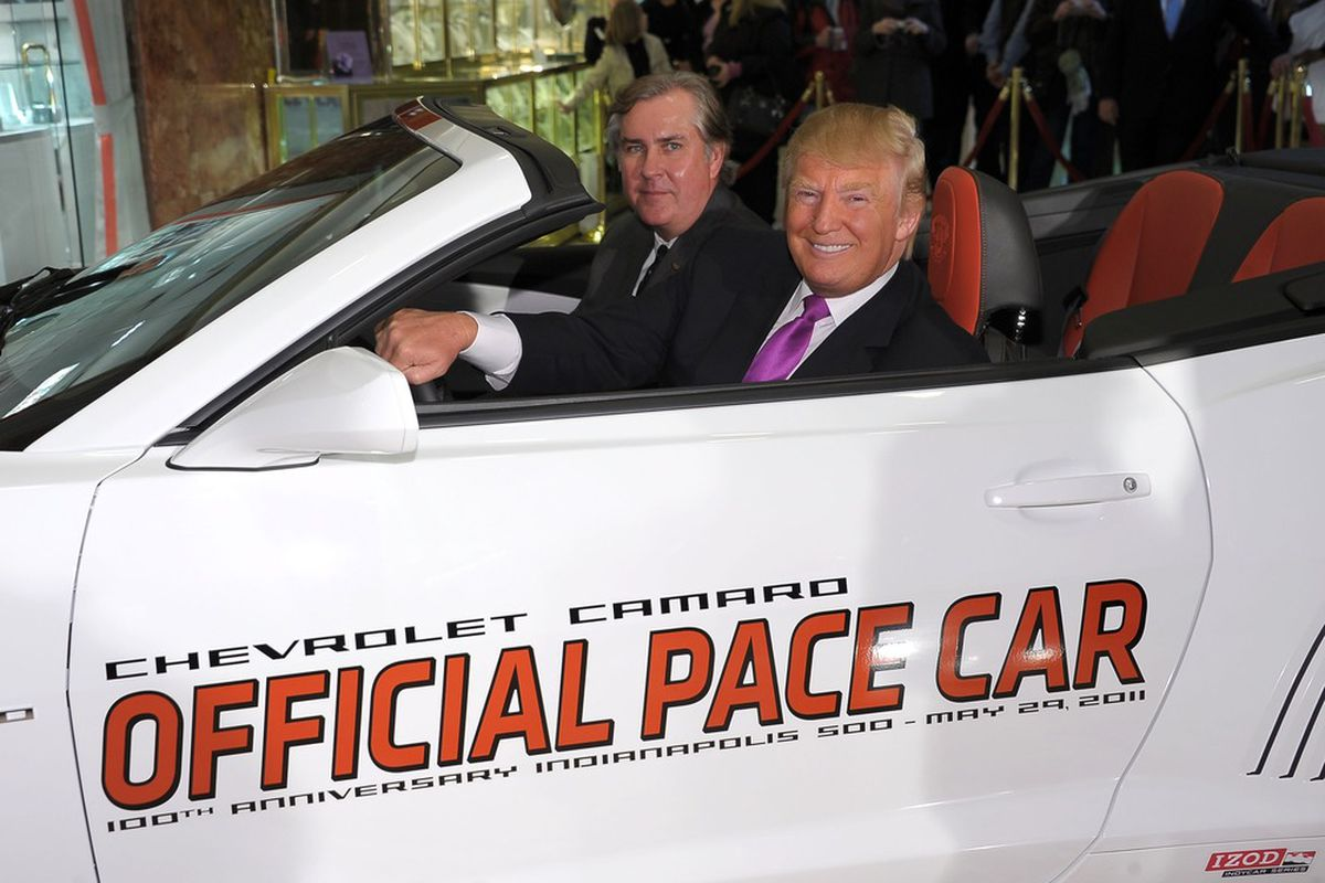 IMS president Jeff Belskus (L) and Donald Trump (R) pose beside the 2011 Indy 500 pace car at a media event on April 5, 2011. (Photo: IndyCar.com)