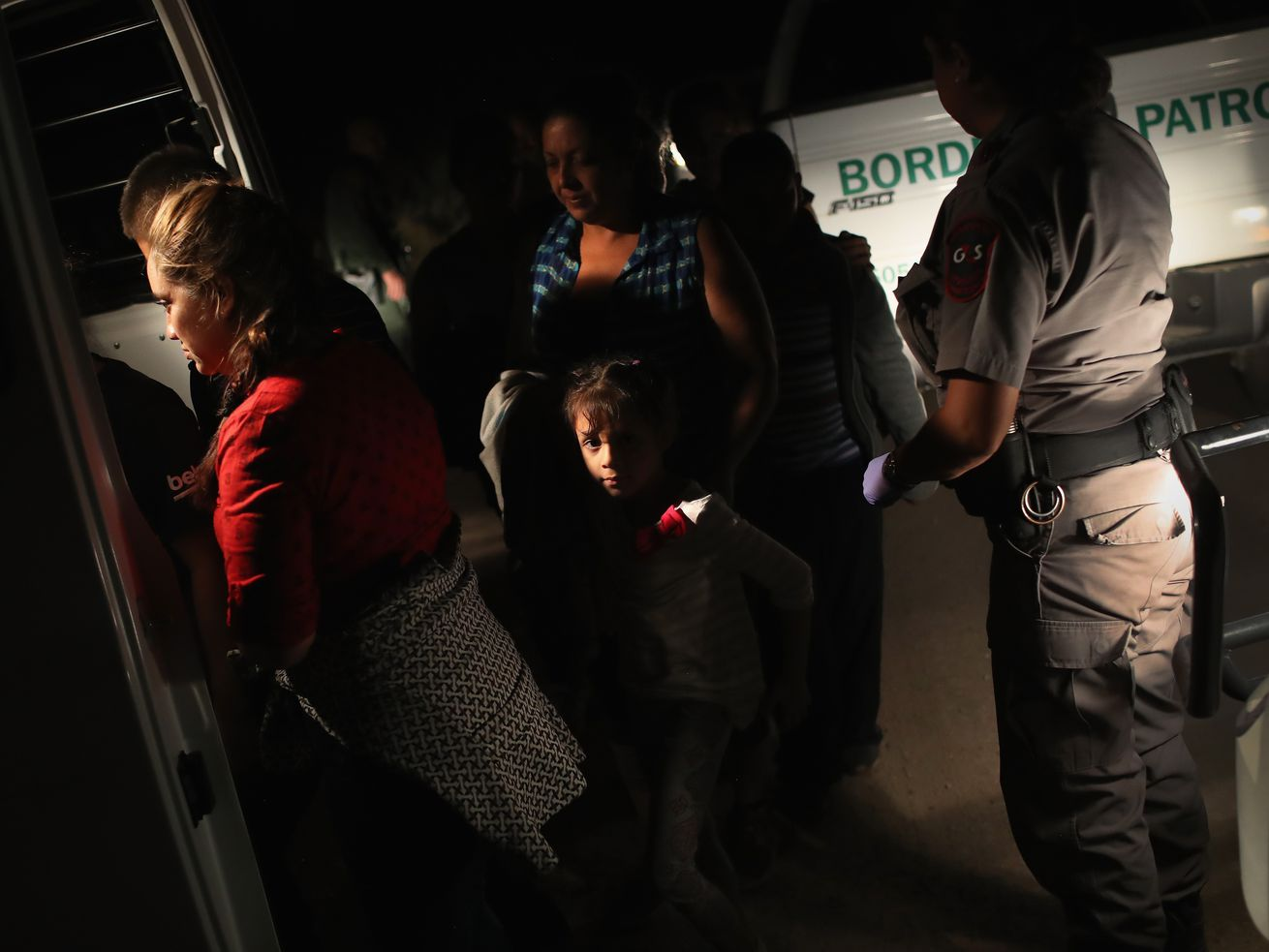 Border Patrol agents detain a group of Central American asylum seekers near the US-Mexico border on June 12, 2018, in McAllen, Texas.