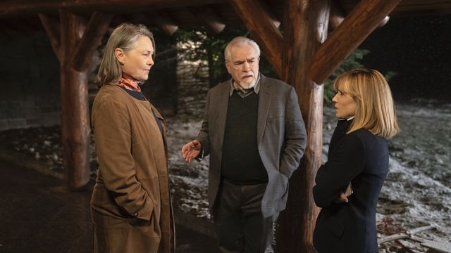 Logan Roy (Brian Cox) stands between Nan Pierce (Cherry Jones) and Rhea Jarrell (Holly Hunter) in a promotional still from Succession season 2, episode 6