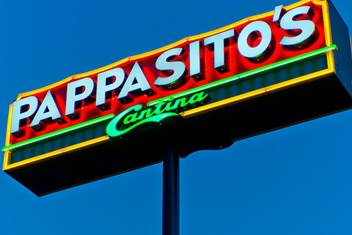 a neon sign against a blue sky that reads Pappasito's Cantina