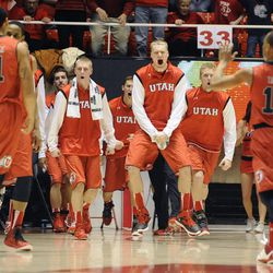 The Utes bench celebrate the teams lead heading into a media timout during a game at the Jon M. Huntsman Center on Saturday, December 14, 2013.