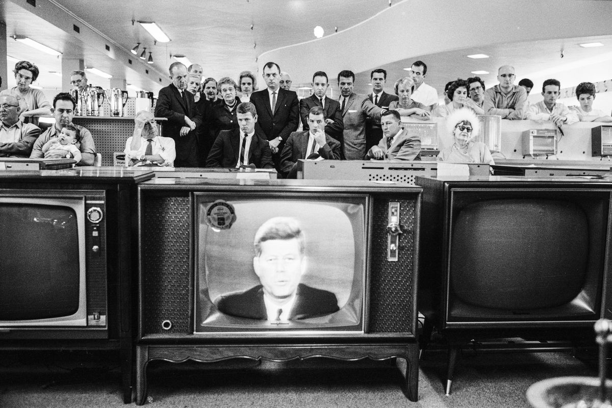 Customers gather to watch President John F. Kennedy as he delivers a televised address to the nation on the subject of the Cuban Missile Crisis, on October 22, 1962.