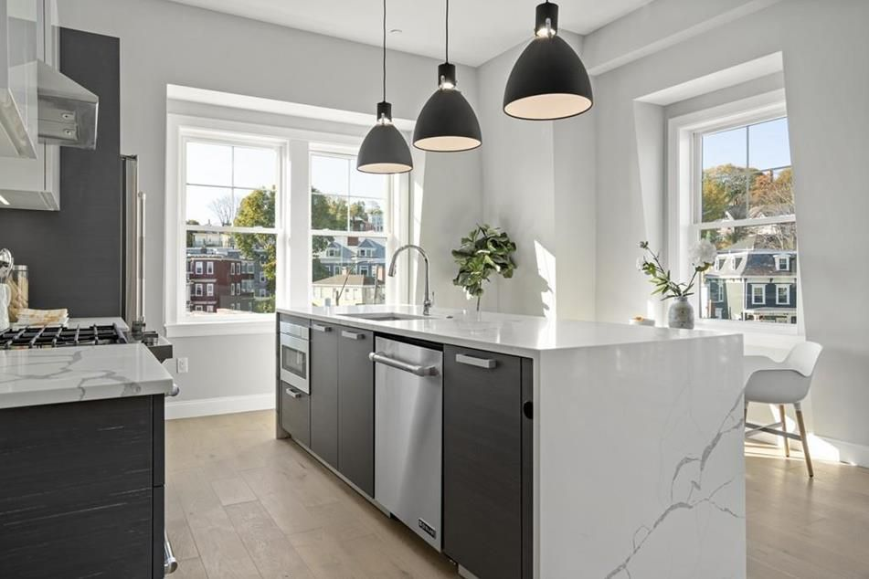 An open kitchen with an island and lots of sunlight.