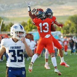 Skyridge's Zeke Greco (13) celebrates catching a long pass with Jack Hadfield against Fremont in Lehi on Thursday, Aug. 12, 2021.