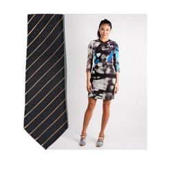 """For a modern spin on cocktail attire, pick a shorter dress with long sleeves and a chic digital print. Find your guy a tie that picks up your dress's primary color while also sporting a subtle pattern.  <a href=""""http://www.gargyle.com/shipley-halmos-alfre"""