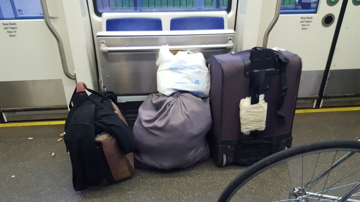 A pile of bags on the streetcar.