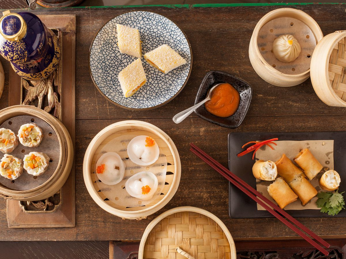 A variety of dim sum spread out on a table.