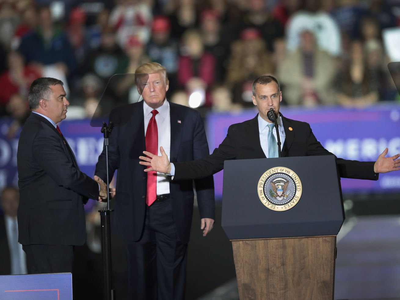 Corey Lewandowski, former campaign manager for President Donald Trump, stands alongside the president as he speaks at a campaign rally on April 28, 2018, in Washington, Michigan.