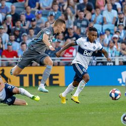 July 27, 2019 - Saint Paul, Minnesota, United States - Minnesota United midfielder Ján Greguš (8) leaps over a slide tackle by Vancouver Whitecaps midfielder Russell Teibert (31) during the match at Allianz Field.