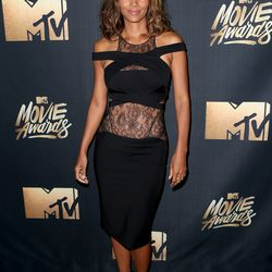 Halle Berry wears a lacy ab-bearing dress.