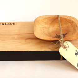 """Created by the hands of Philadelphia artist/woodworker Ben McBrien of Farmaus, this <a href=""""http://www.artstarphilly.com/shop/farmhaus-plaid-pack/"""">Reclaimed Walnut Cutting Board and Bowl Set</a> ($175 at Art Star) is almost too pretty to use. Almost."""
